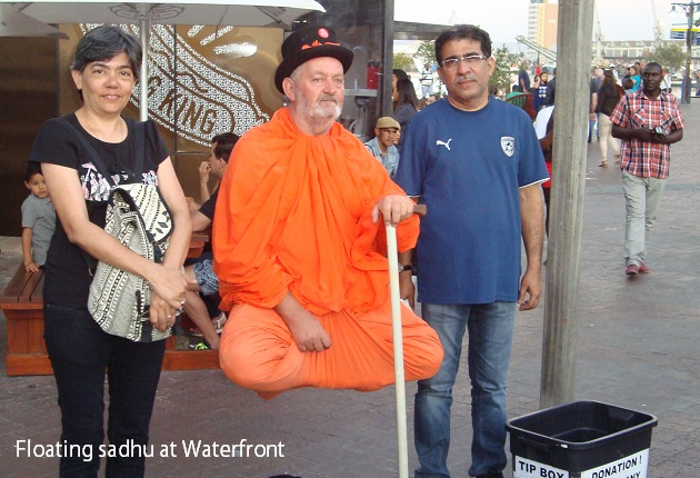 A floating sadhu collecting alms at the V&A Waterfront, Cape Town